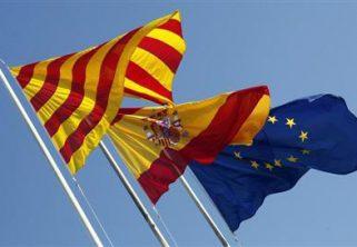 Flags of Catalunya, Spain and EU wave near Barcelona - Spanish Nationality